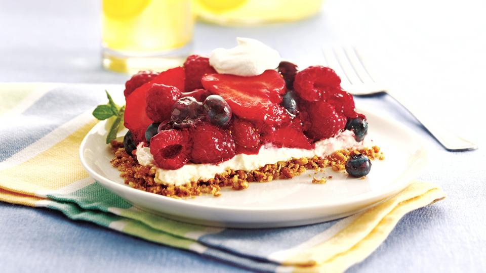 Pile on the berries! Love every delicious forkful of crunchy granola crust, creamy filling and tart berries.