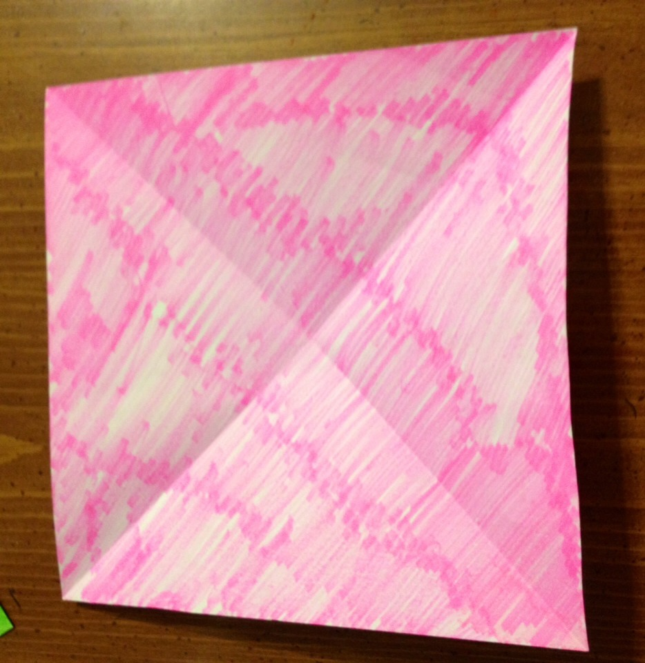 When you unfold it you will have an X made from the creases where you folded it