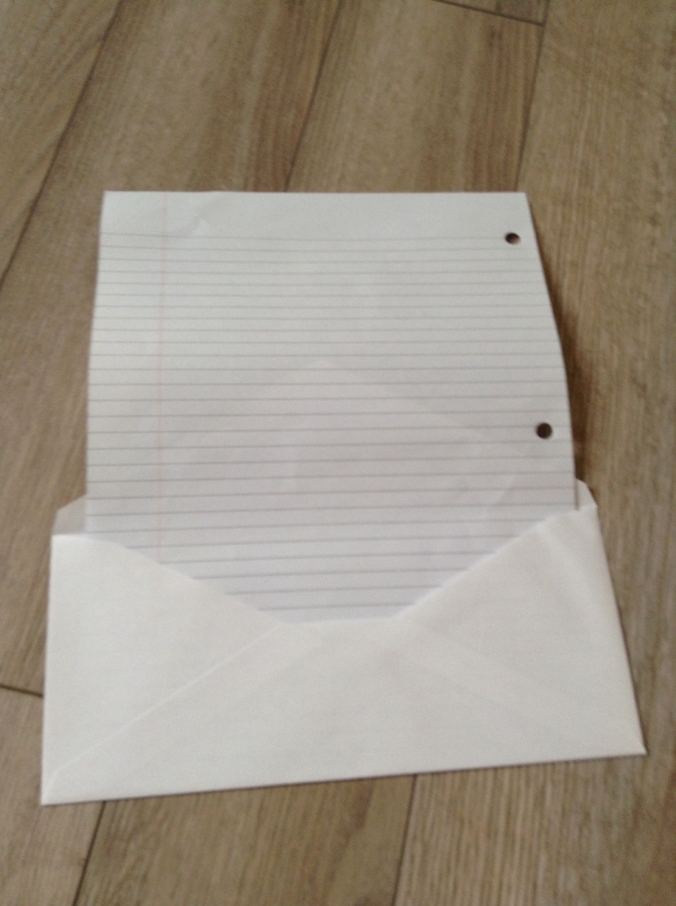 Place the line paper inside the envelope like so