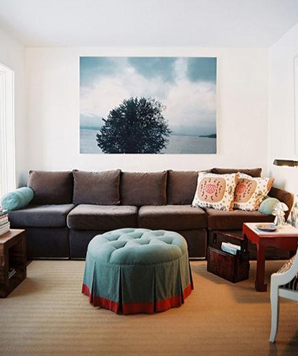 Plus Size Arranging An extra-large sofa can mean plenty of room to stretch out, but it can also engulf a room. The trick is to anchor an oversized piece of furniture against a wall and use other voluminous accessories (a jumbo print or a king-sized ottoman) for balance.
