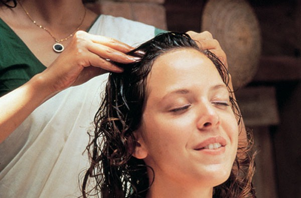 Warm up the olive oil and apply to scalp while massaging