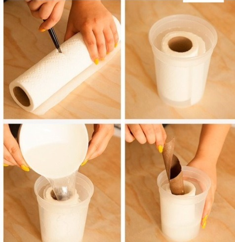 Then cut your kitchen roll in half,put your cut kitchen into the tub and then pour your mixture into the tuba and remove the cardboard from the tissue roll