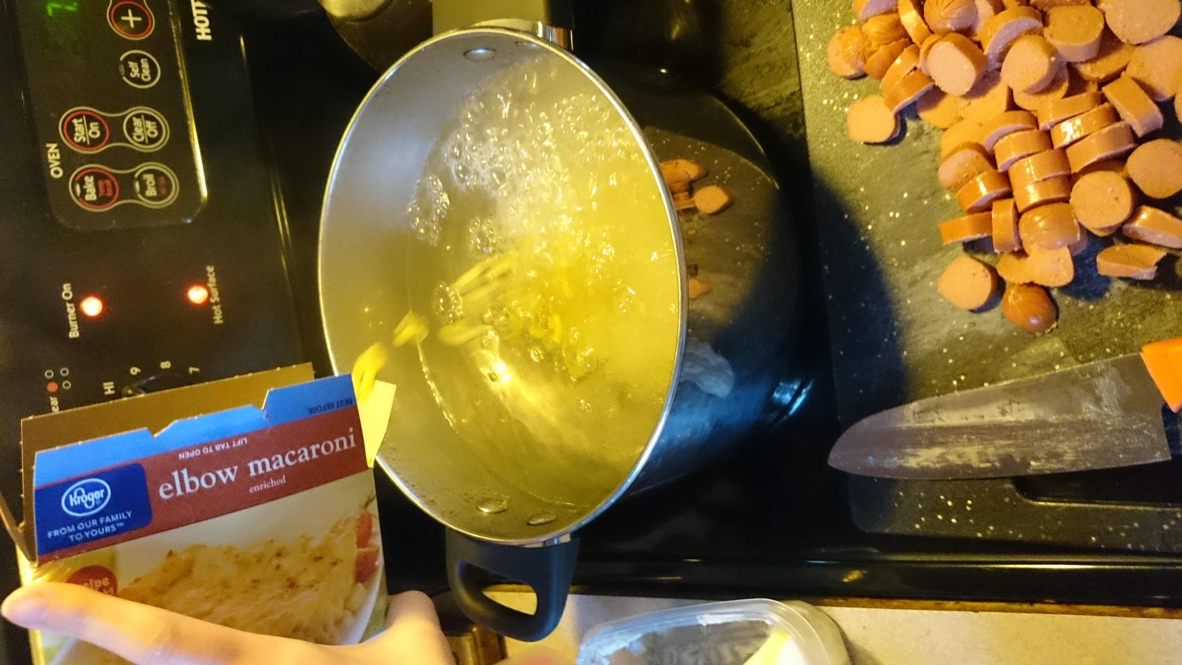 By this time, the water should be boiling, so add the macaroni noodles, set your timer for 8 minutes, stir the pasta, and add some salt to the water.