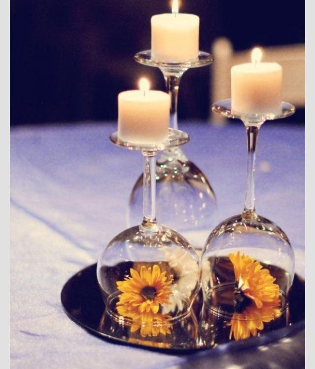 Candles, mirror, wine glasses, colorful flowers.