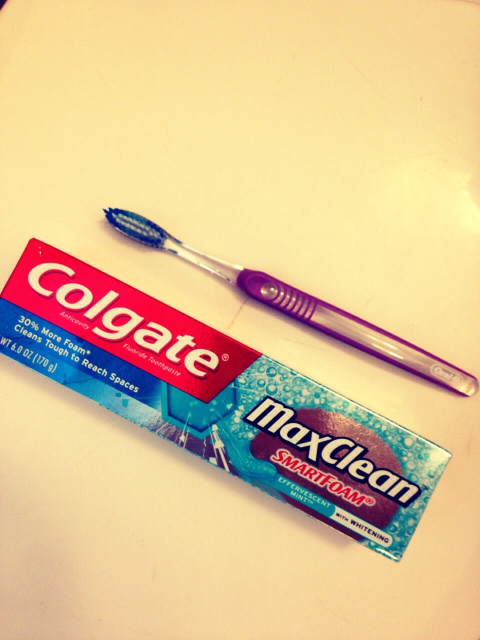 Take an old toothbrush and toothpaste (preferably whitening paste)