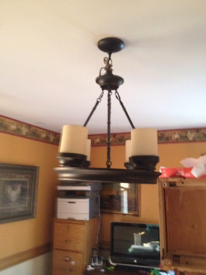 This lighting fixture is in my kitchen my son and hubby were always hitting there heads(we move our table around a lot) so I just bought a rope climbing hook and attached the bottom chain piece to the top chain piece the I just wrapped a decorative piece of fabric around the top part not shown here