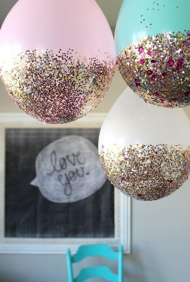 3. Hang these glitter balloons from the ceiling to provide a sparkling sky to fall asleep below.