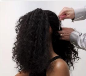 (5) With each section, pull the hair tight to create 3 ponytails going in a line from the crown of the head to the nape of the neck. Spray fly aways down with Extra Firm Hold hairspray, and smooth out with a fine-tooth comb.