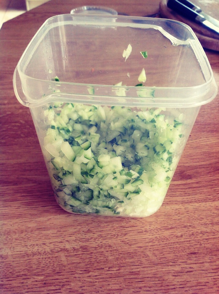 Choose container (I choose a plastic container with lid to store in fridge) add chopped cucumber and onion to container