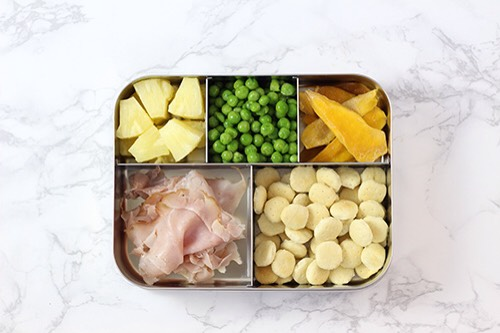 3 | Ham and Pineapple Lunch Combo What vegetable goes better with ham than peas?! Oyster crackers and dried mango are two of our favorite things to munch so they round this lunch off perfectly.  1. Ham 2. Peas 3. Pineapple 4. Oyster crackers 5. Dried mango