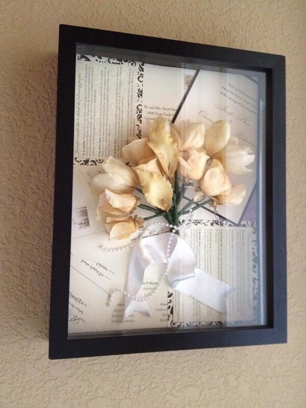 Dried wedding bouquet with invitations and announcements