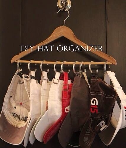 Great for your husbands closet. All you need is a hanger and shower curtain rings. A great way to organize his hats, ties, or even your handbags !