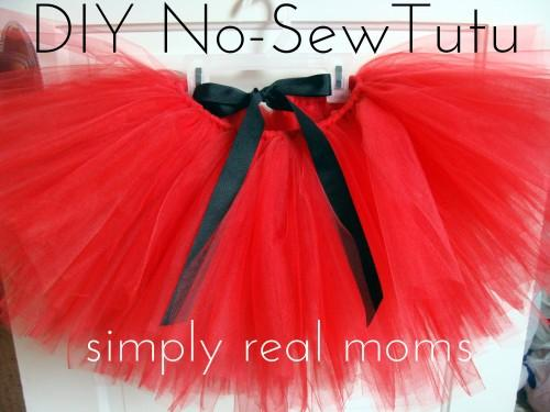 Supplies:DSC02389 225x300 Adorable DIY No Sew Tutu  Tulle (either on spools, or by the yard) in your desired color 7/8″ ribbon in your desired color Scissors (or rotary cutter and mat) Measuring tape
