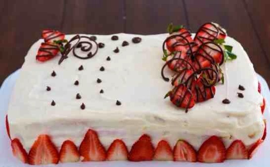 Decorate the top with fresh strawberries and chocolate