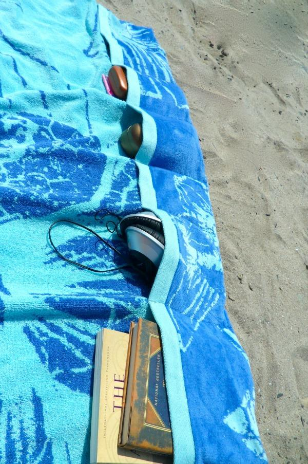11. Sew pockets onto your beach towel You can keep stuff in there AND weigh the towel down.