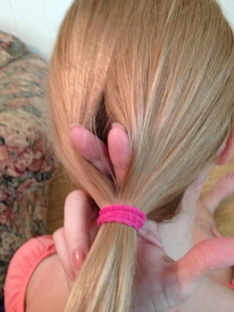 Take your finger and stick it through your hair right above the hair tie. Then just pull the pony tail through that hole and you're done!!