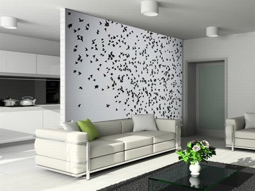 Put up stickers of stencils to spice up your bare wall