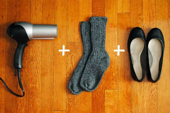Another way to stretch in or make shoes or flats bigger is to put on a thick pair of socks then wear the shoes and blow hot hair from the dryer in spots needing to be stretched .
