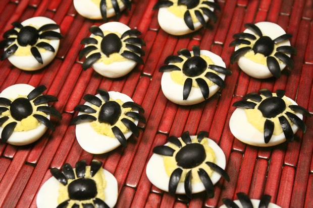 Make a batch of deviled eggs. Then cut up a black olive to make the spider to top it off.