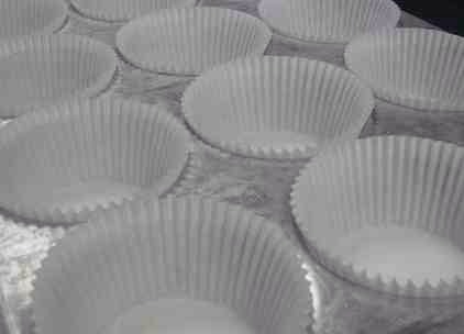 Place cupcake liners in the cups over the rice. Liners will sit slightly out of the cup. Fill liners with cupcake batter and bake according to recipe instructions.