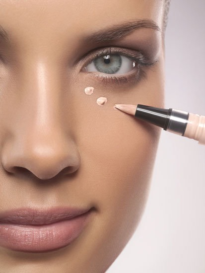 Next stop is concealer. Concealer hides your blemishes, such as pimples or dark circles under your eyes.