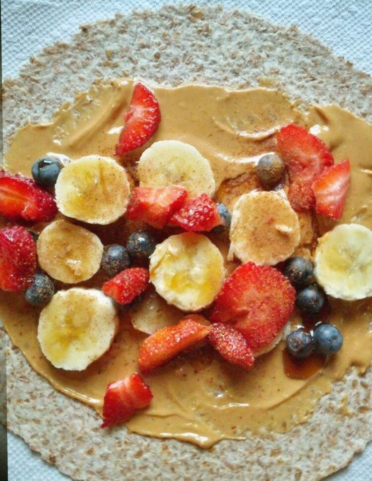 Any kind of wheat bread, toasted! Then apply peanut butter on top, then top it off with fruits (your choice),  Last sprinkle cinnamon on top. Now it's ready to eat!