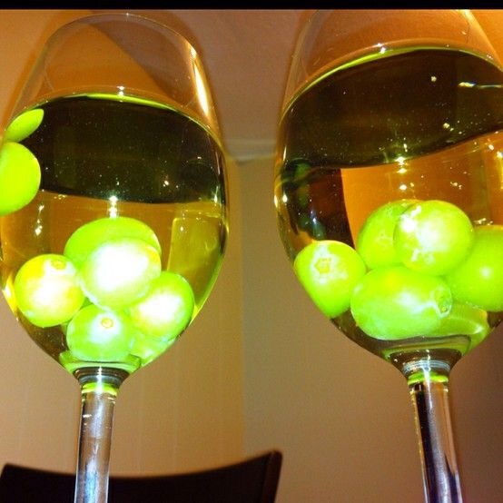 Add frozen red or green grapes to ur white wine before serving it to ur guests. This gives a great look to the drink and keeps ur wine cold for long.