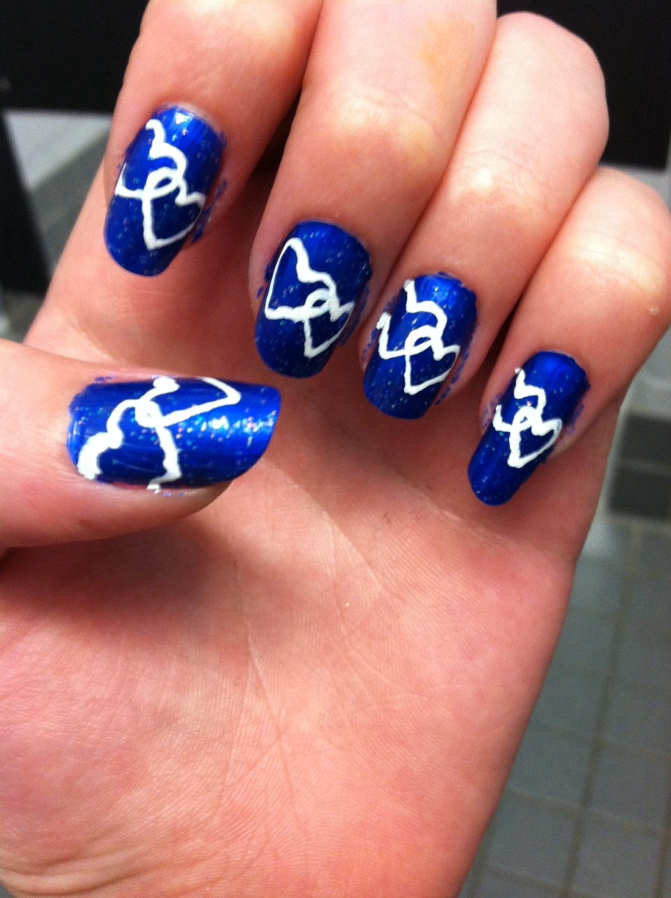 Hearts locked together use a nail pen and start your design and follow for more beauty tips