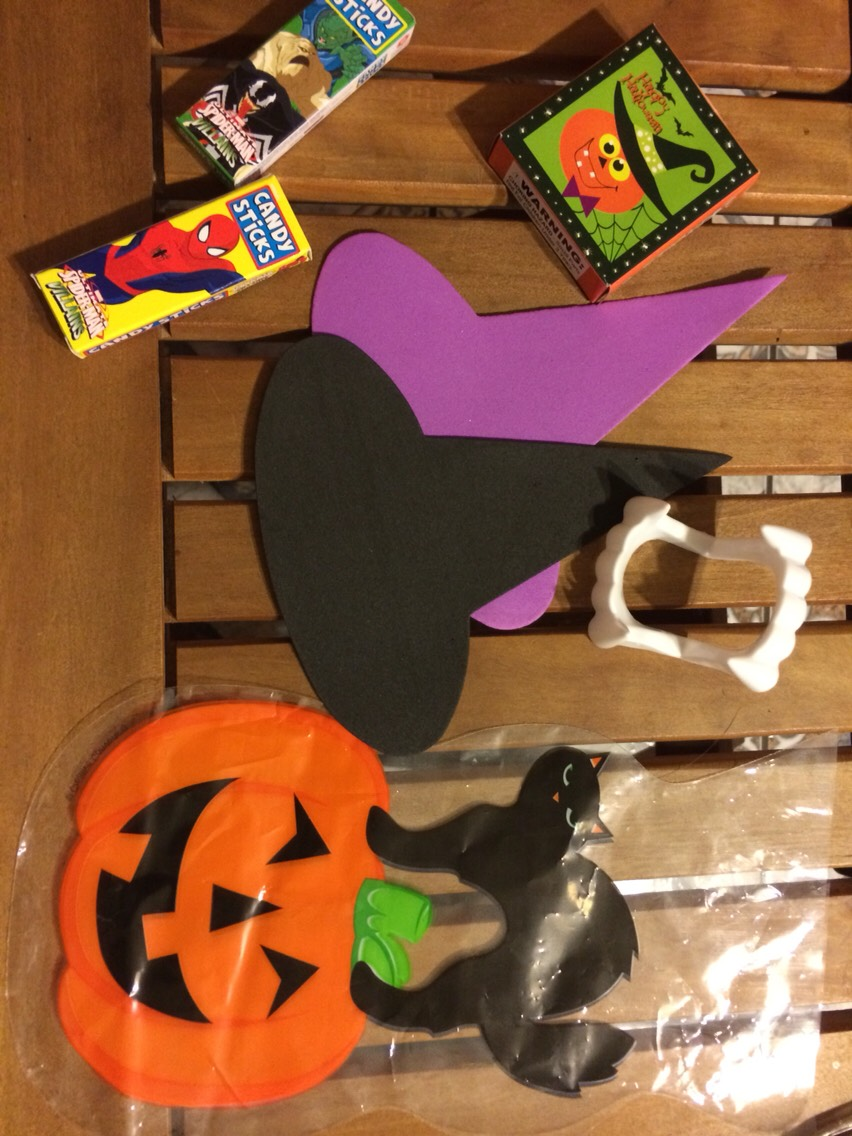 Goody bag, stickers, teeth, 2pieces of candy, and a hat.