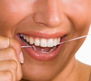 Floss twice a day, especially between your front teeth