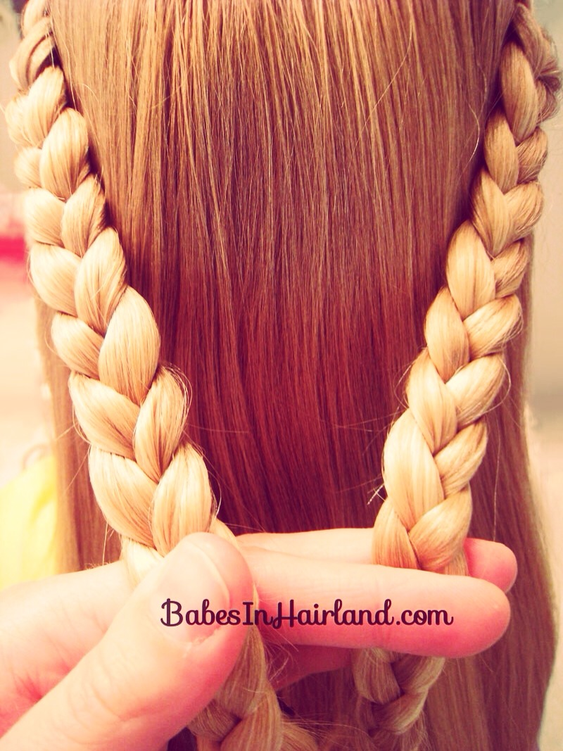 Then create two plaits or fish tail plaits ( either is fine) with both sides of your hair ( abit bigger than the ones in this photo) and then join them together with a hair bobble.