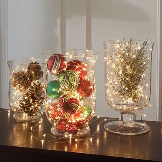 Light up your table with vases or bowls full of delicate micro strands of light either on their own or with some other holiday decor elements you have laying around, like this example fromBrookstone.