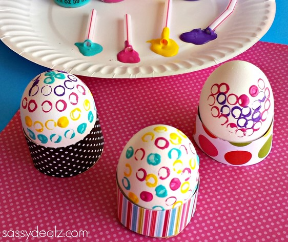 scrapbook paper and glue them to the toilet paper rolls to finish!
