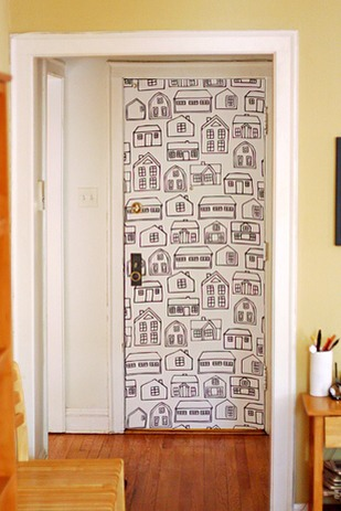 Take a paste of corn starch and water to paste on a temporary wallpaper on a door that can easily be take off when ever with no head aches or mess