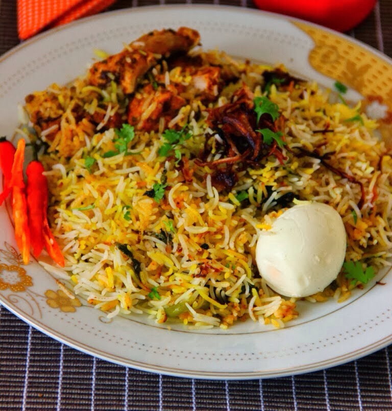 Description: chicken biryani cooked in pukhi style ( cooked seperately)  Chicken biryani cooked in pukhi style of cooking the rice and chicken separately and then combining together