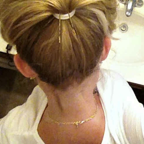 Get fuller looking ponytail with this hack! Try using a similar color bobby to your hair so that it is not obvious!