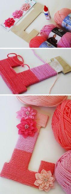 Wrap yarn around a letter made out a wood