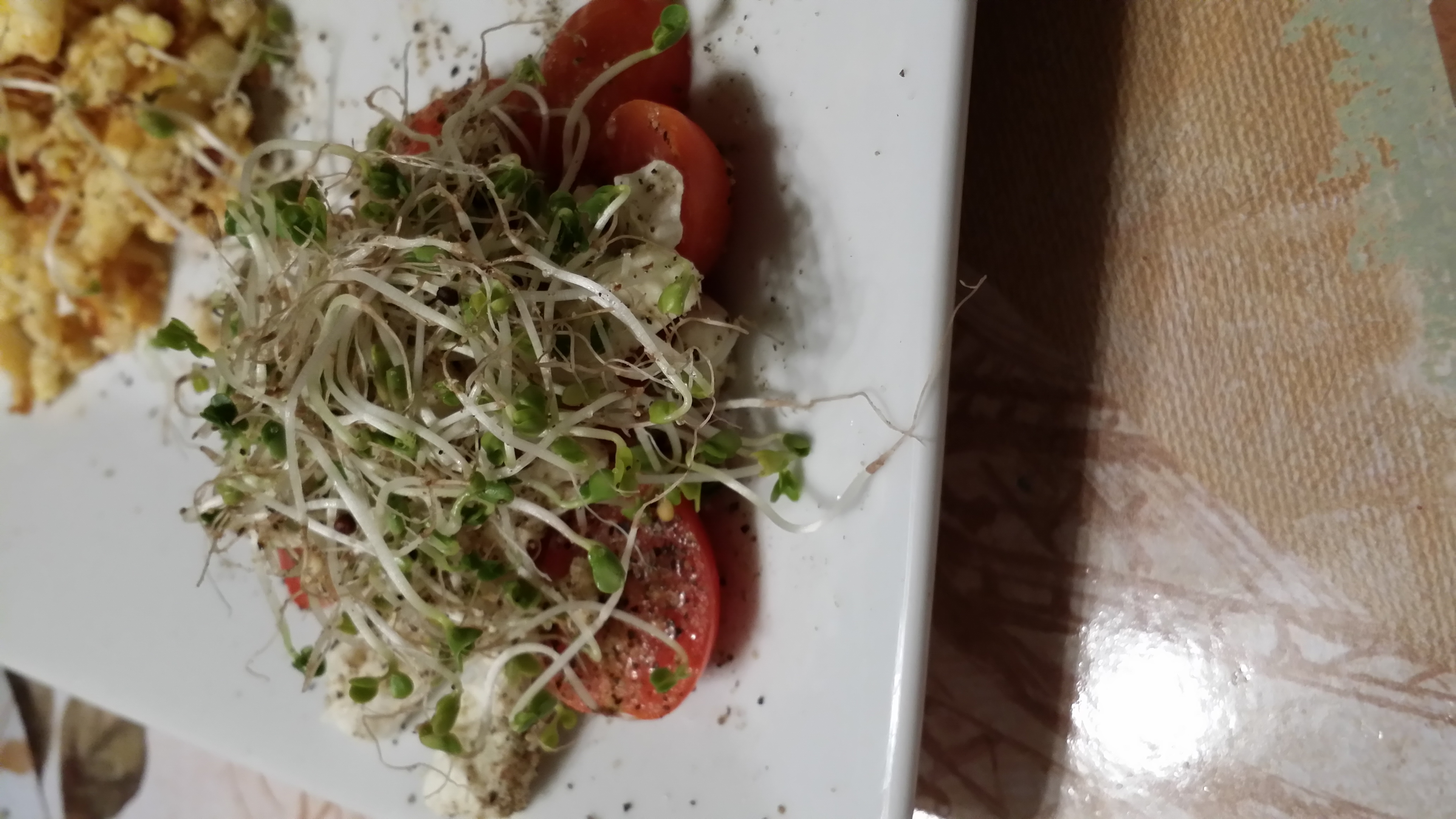 slice tomatoes put feta cheese, & broccoli sprouts on top. drizzle with olive oil & your done