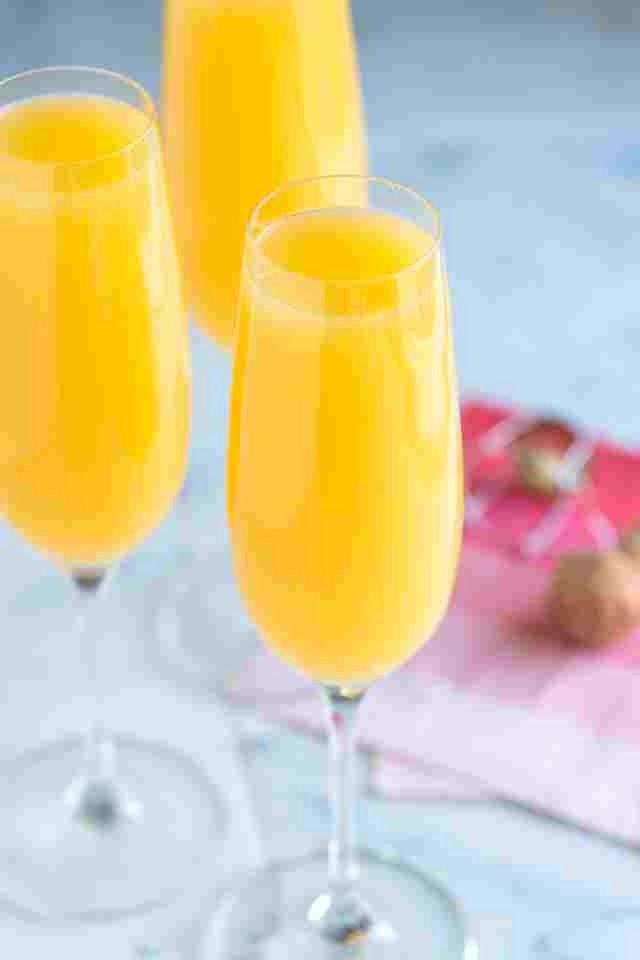 Buy peach flavored champagne! Oh my gosh it's amazing and really spices up a regular version