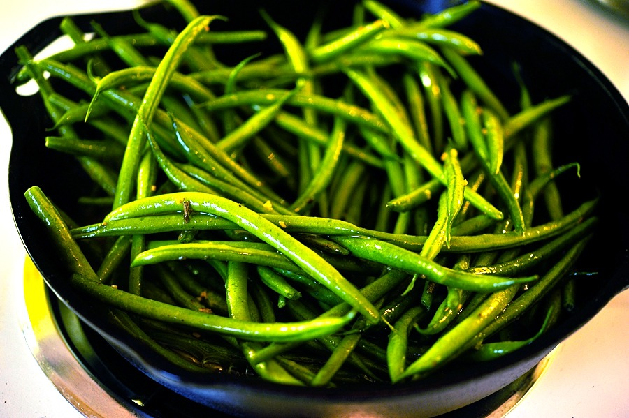 Heat a skillet over medium-high heat and add the green beans. Cook them for 5 minutes or so, tossing every so often.