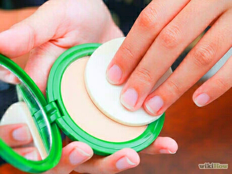 4.Apply loose powder or pressed powder evenly over the foundation.Don't use much, and lightly press on and dust off the excess. This prevents you from rubbing off your beautifully applied base.The light powder layer prepares your face for smooth applications of other powder such as blush.