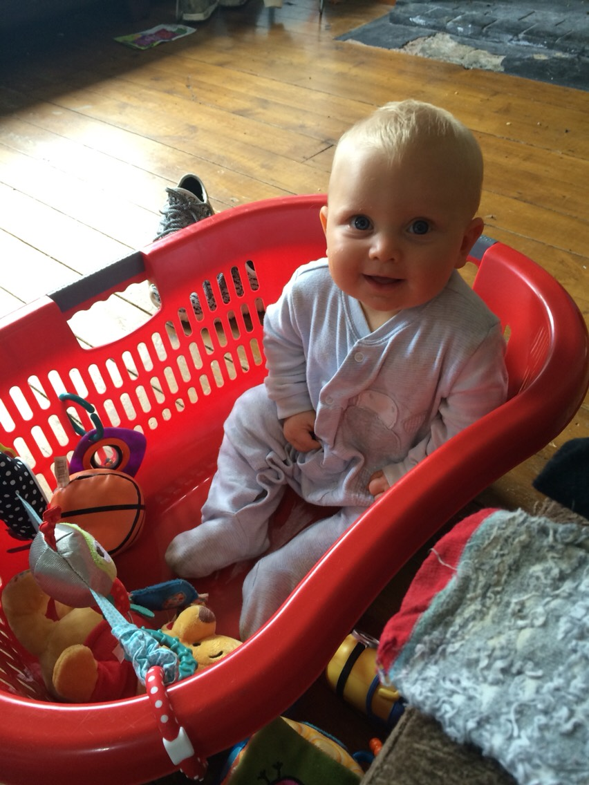Fill the basket with toys and let your baby sit independently.
