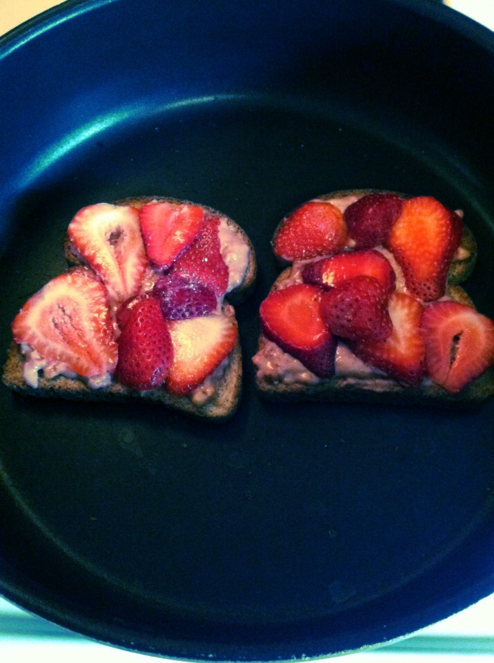 Cut up the rest of the remaining strawberries and place them on top of the toast slices