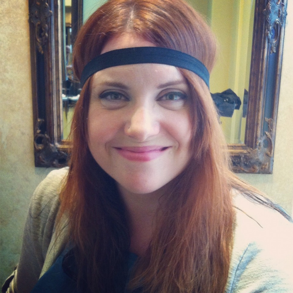 Simply place an elastic headband on your head (be sure to place the band where you would like your curls to start)