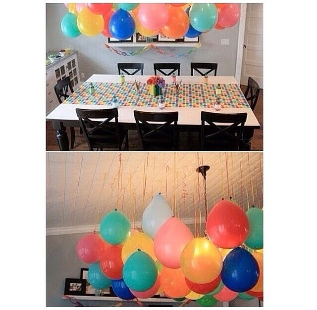 Hanging balloons upside down to create a beautiful setting for any age party! (I use thumbtacks)