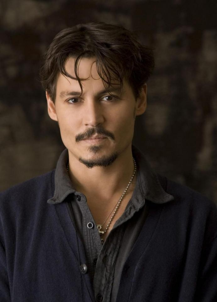 Johnny Depp's Shaggy hair is a good look for the bad boy in town. A great look for a guy that wants to put on his motorcycle helmet and drive down the coast. This look is perfect for men with medium-length hair.