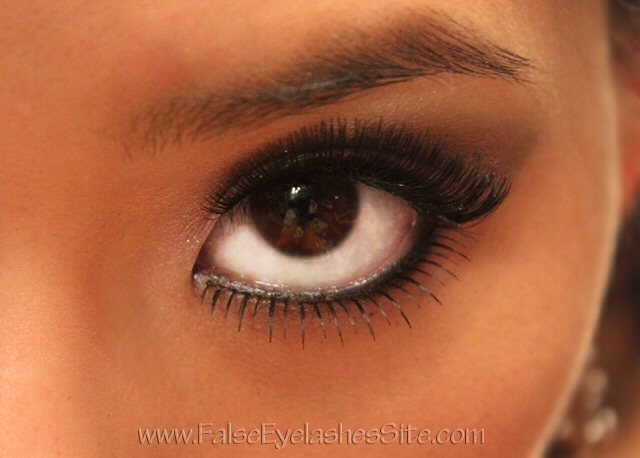 To finish up your eye look, add some false lashes to really make your eyes pop. To blend the false eyelashes with your real ones, apply the falsies, curl your lashes together, and apply a coat of mascara to seal them together. If there are any gaps or any glue showing, cover it up with eyeliner.