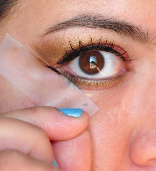 """3. Scotch Tape Eye Stencil This unconventional beauty aid will help guide you when applying eye liner and shadows, especially if you're going for a more daring look such as the """"cat eye"""". It will also help you achieve an even and balanced look for both eyes."""