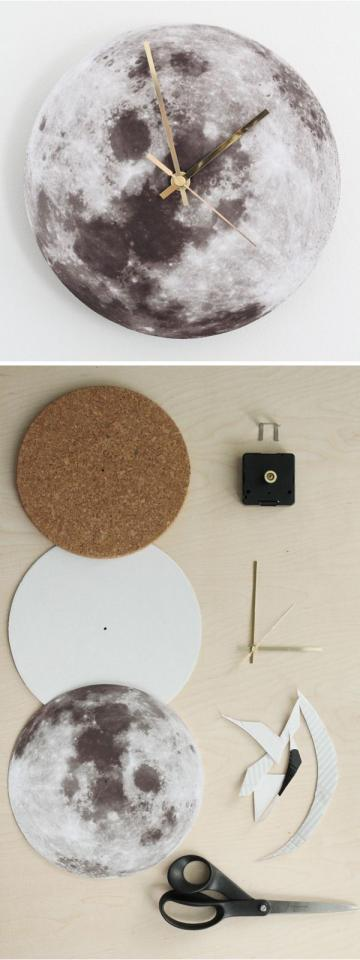 cut equal circles from one sheet of cork, 1 sheet of thick paper and printed photo of the moon. Make a hole in their centres. Stick them together and place a clock mechanism.