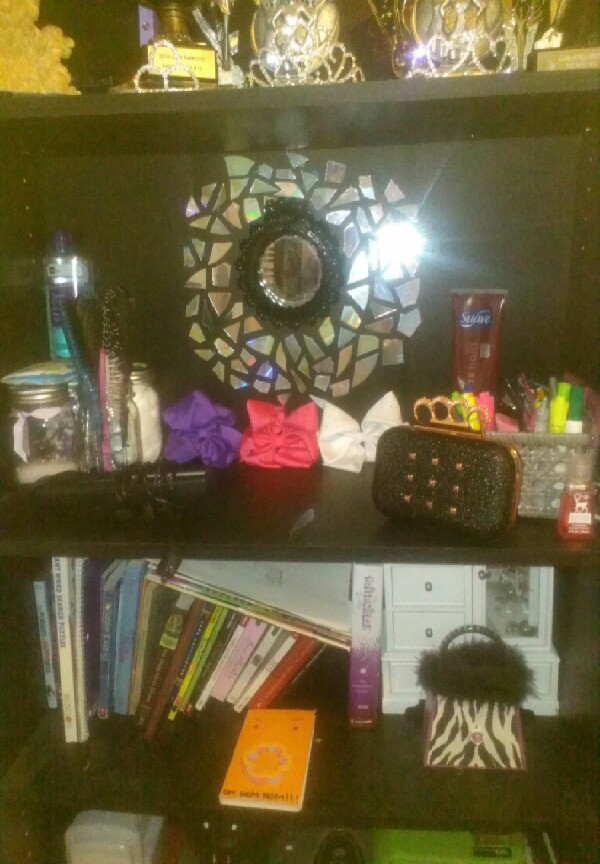 here is how you add style with cut up cds to your bookshelf or you can use this anywhere